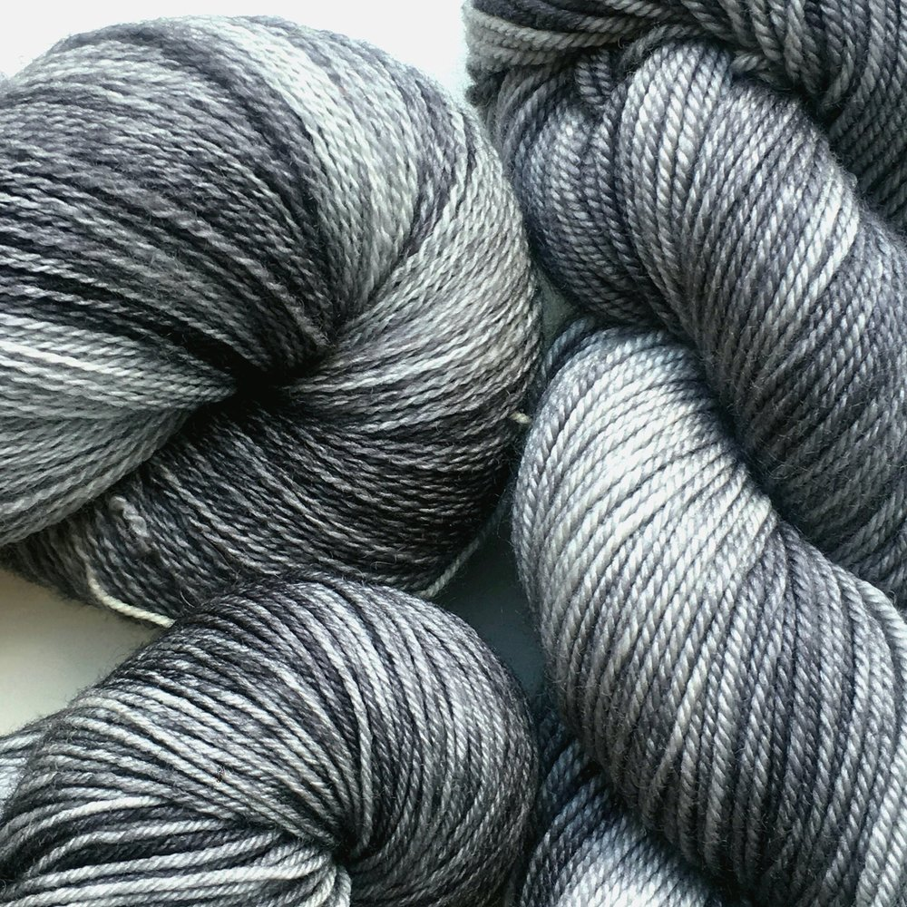 Graphite  Neutral, tonal grey.  Shown on All Your Base, Sheepy Feet, and Silky Merino Sport.