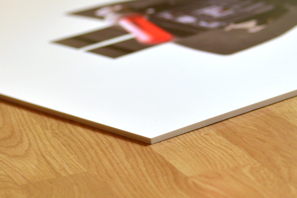 Our prints are made with archival pigment ink on 1/4 inch engineered polymer. This rigid yet flexible material is a durable alternative to conventional framing - and you never have to worry about breakage.  Prints are washable, and they will never chip or peel.