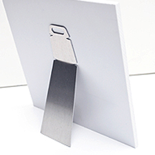 Easel - This aluminum easel makes it easy to display your print on any surface. Can be used on any print up to 16x16 inches.