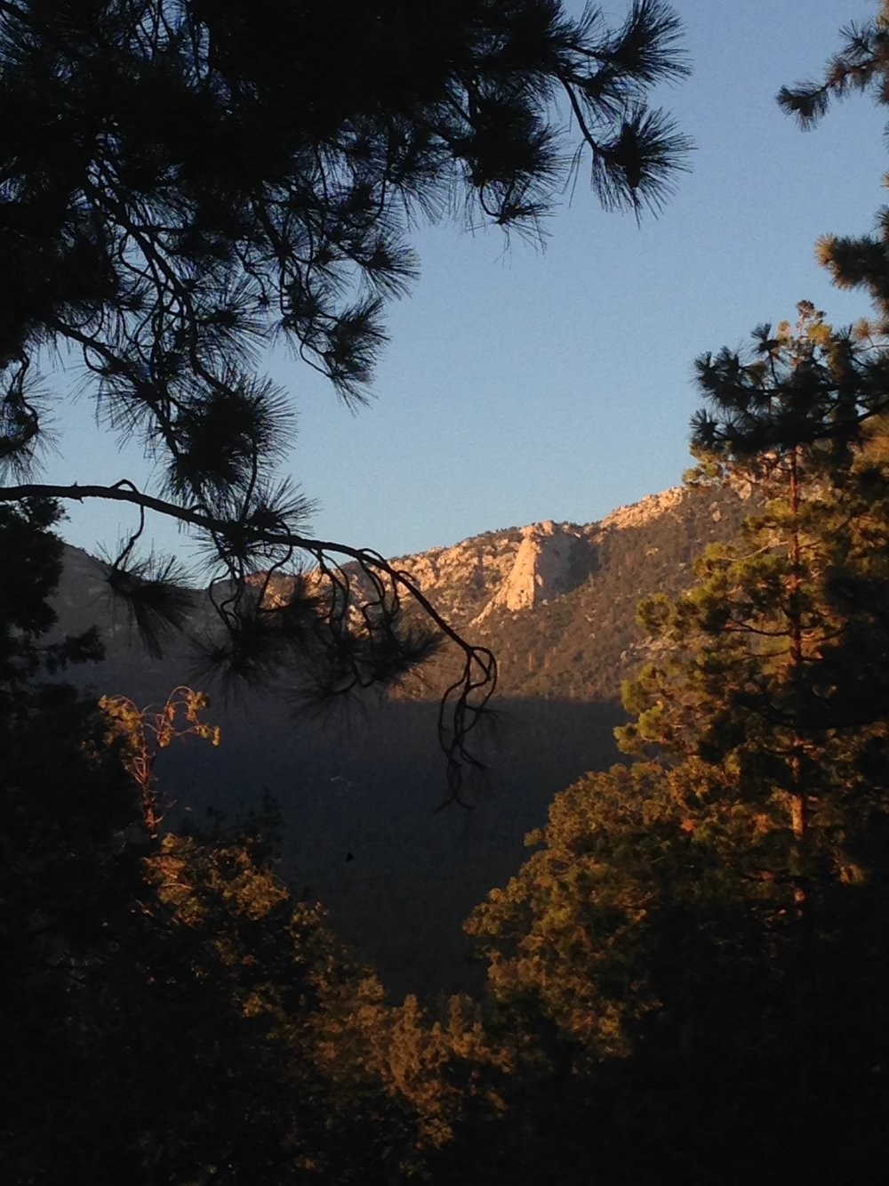 Deck Life: The view of evening Alpineglow hitting Tahquitz Rock from the Girls Gone IdyllWEED Cabin in Idyllwild, CA.