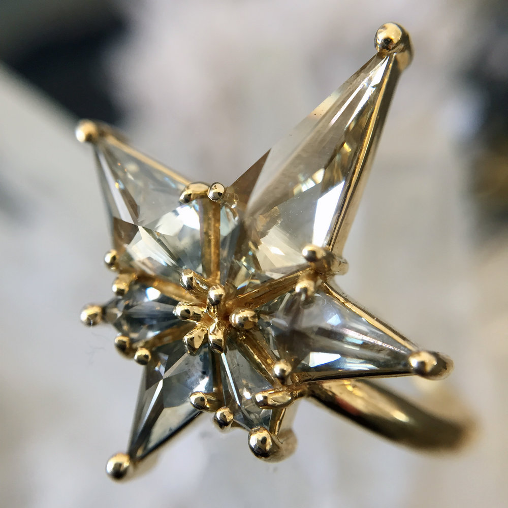 STARS IN HER EYES - Six, gray-green kite-cut diamonds come together to create a One of a Kind wonder. This celestial luminary radiates serious star power!