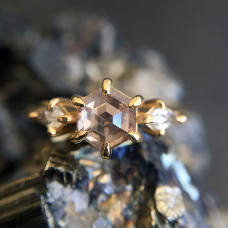 supernova - Her heart will explode when she sees this triple star burst of diamond divination. Two white, kite-shaped galactic diamonds detonate from each side of a stellar hexagonal .89ct champagne diamond, equaling 1.08 total carats of star dust.