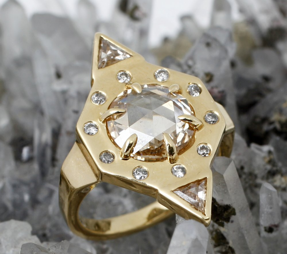 PRINCESS OF POWER - She'll feel like the Mistress of the Universe wielding our one of a kind diamond shield ring! Power up with 2.81 total carats of diamond dust. This stunner will ensure you'll be together for all Eternia.