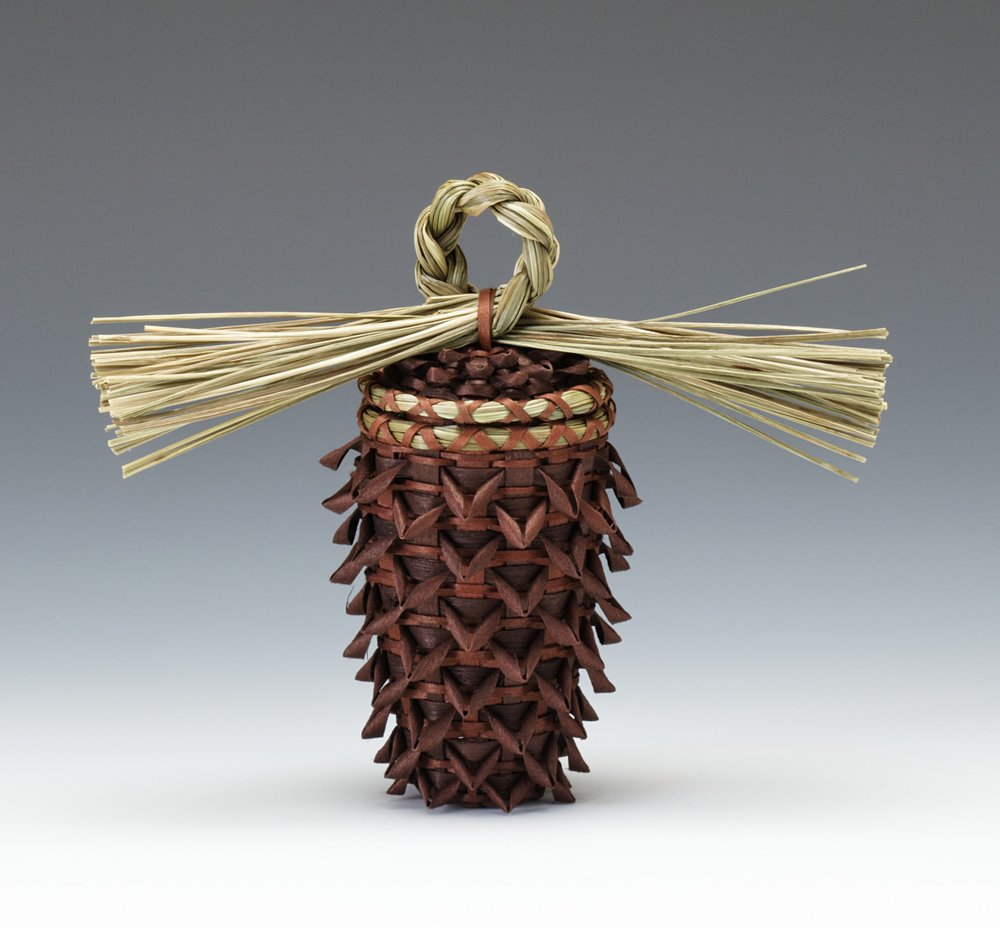 Kim Bryant, American (Penobscot), born 1964, pinecone basket, 2008. Brown ash and sweetgrass; brown dye, 4 1/4 × 1 1/2 in.Hood Museum of Art, Dartmouth College: Purchased through the Hood Museum of Art Acquisitions Fund; 2008.69.