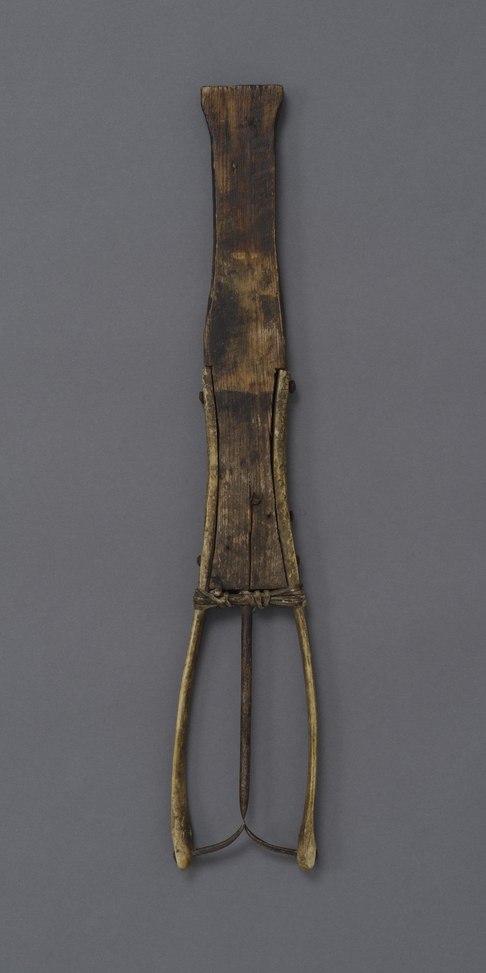 Canadian (Inuit), fishing spear or leister, 19th century, collected 1920–30. Wood, caribou bone, and leather. length: 18 1/4 in. Hood Museum of Art, Dartmouth College: Gift of Robert O. Fernald, Class of 1936; 158.25.14219.
