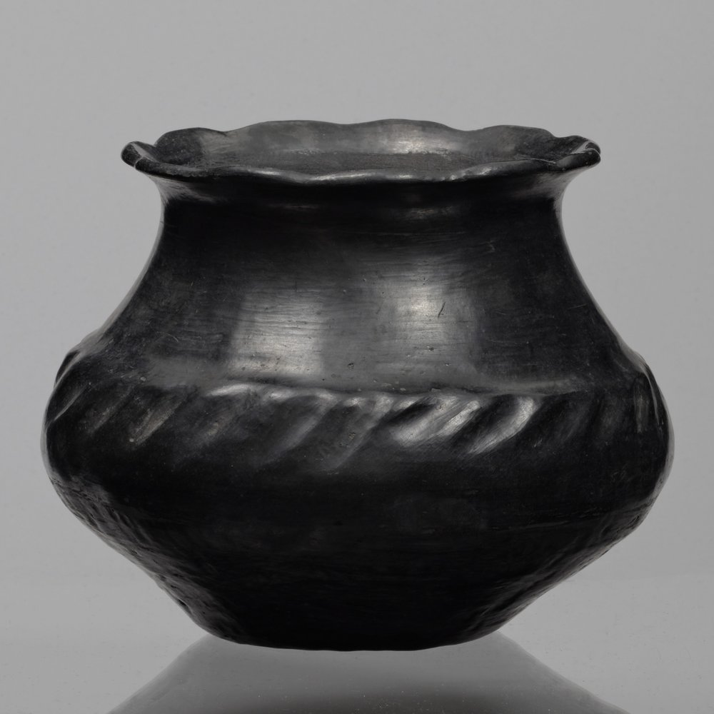 Santa Clara Pueblo (Kha P'o),New Mexico,olla, collected about 1903–7. Blackened terracotta, 6 5/16 × 5 13/16 in. Hood Museum of Art, Dartmouth College: Bequest of Frank C. and Clara G. Churchill; 46.17.10043.