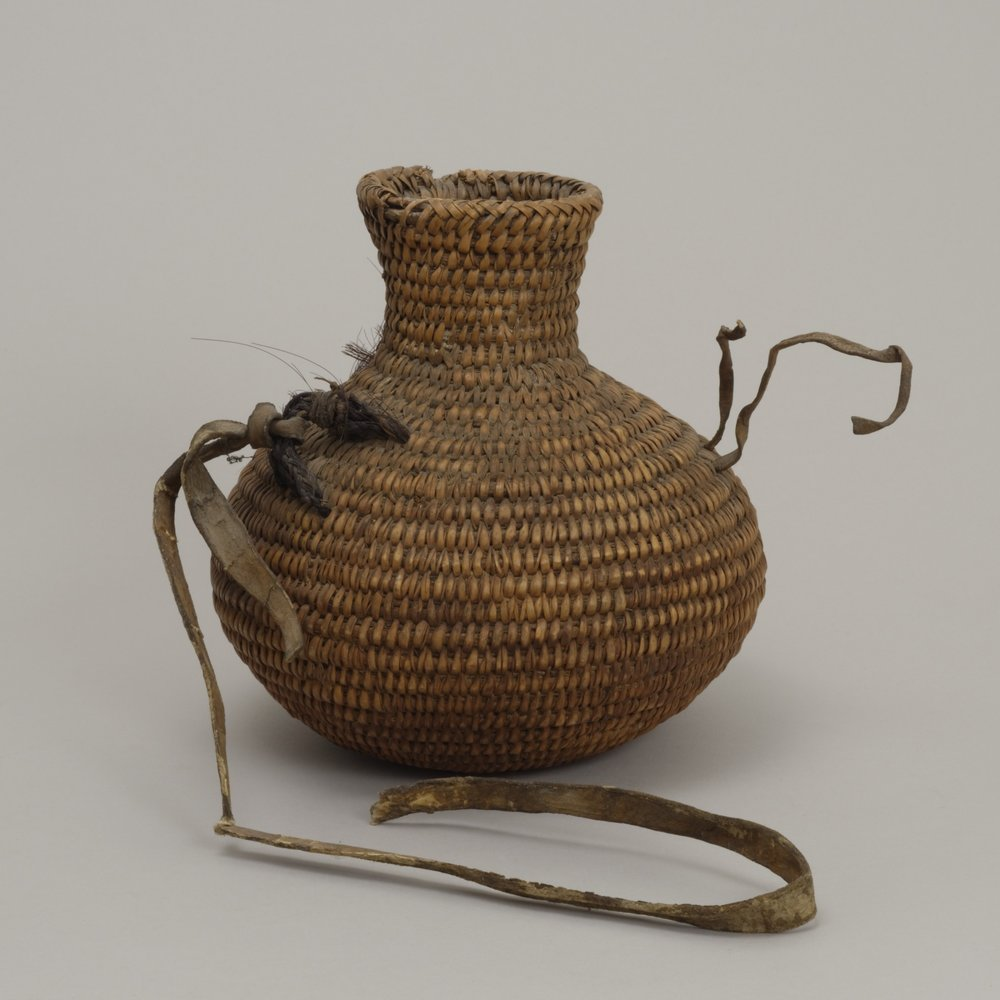 Jicarilla Apache, coil-basket water bottle, collected 1887–1906. Plant fiber, horse hair, and leather, 8 11/16 × 8 1/16 in. Hood Museum of Art, Dartmouth College: Gift of Mrs. Ida Farr Miller; 44.18.8779.