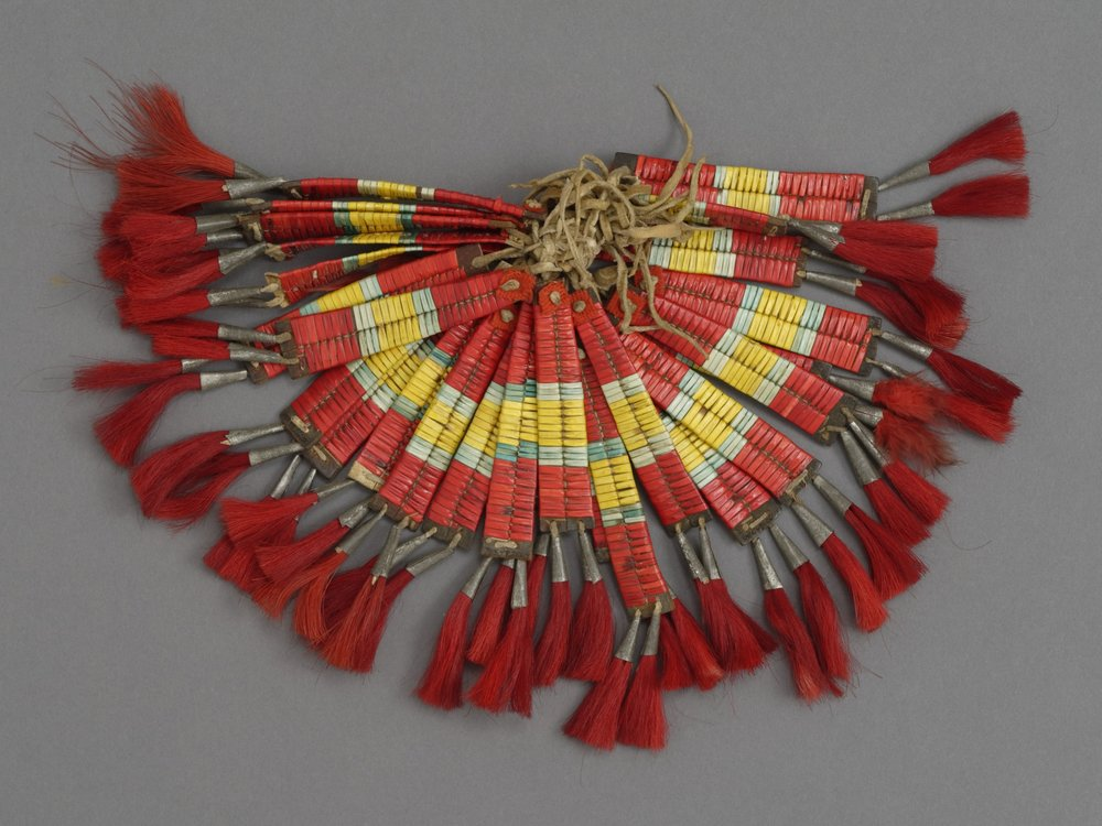 Unknown people (Plains),26 tipi ornaments, early 20th century. Commercial leather, quills, metal, and horsehair, 5 7/8 × 13/16 in. Hood Museum of Art, Dartmouth College: Gift of Guido R. Rahr, Sr., Class of 1951P; 985.47.26614.