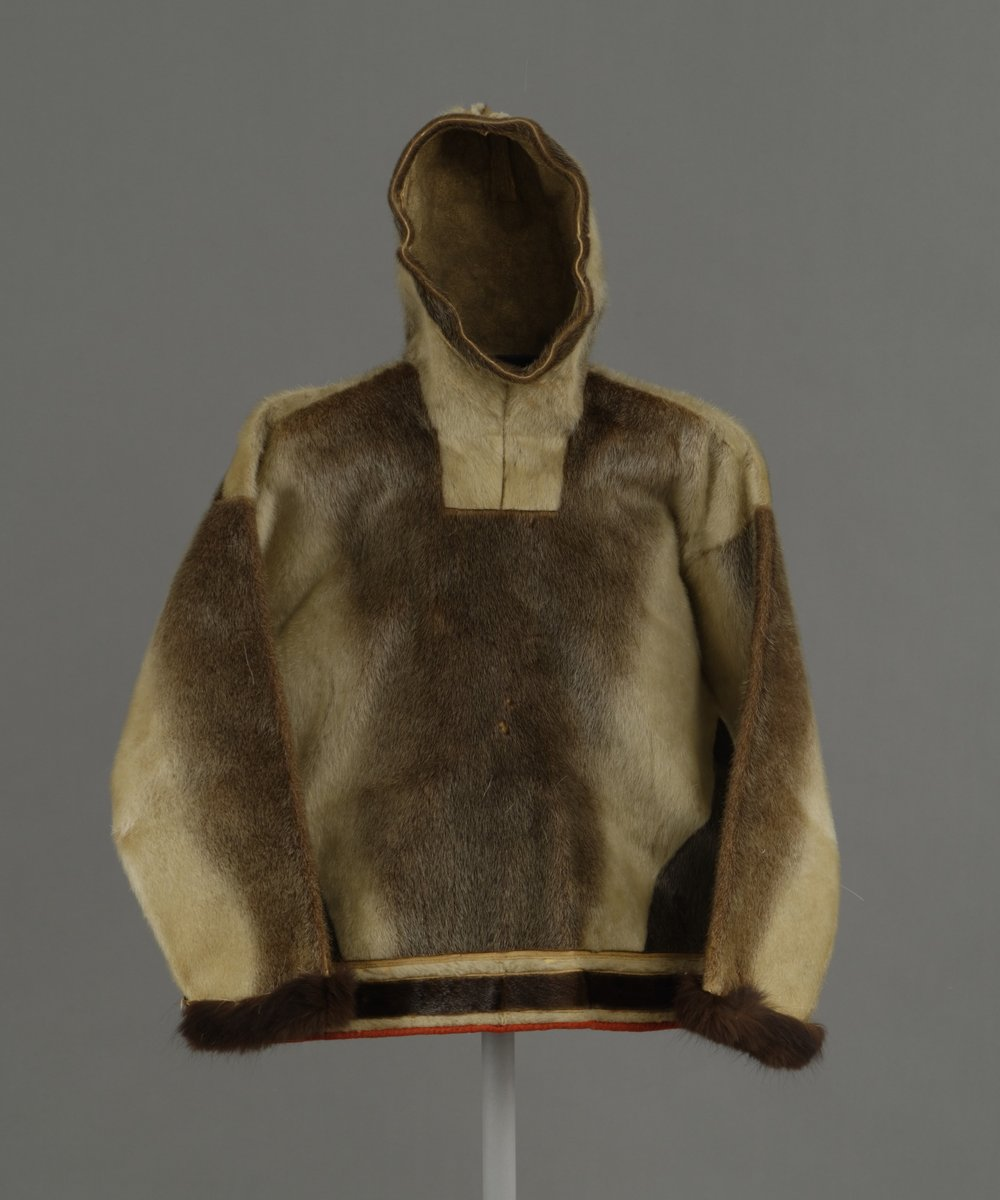 Kalaallit (West Greenlandic Inuit), men's hooded parka for spring and summer, about 1897. Sealskin, dog fur cuffs, sinew, and cloth, height: 36 1/4 in. Hood Museum of Art, Dartmouth College: Gift of Mrs. William Stickney, Class of 1900W; 164.21.15428.