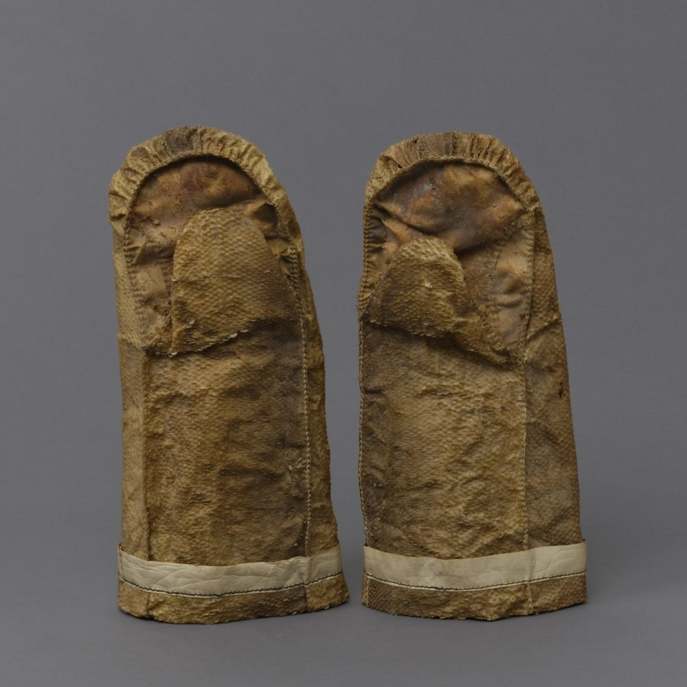 Unangax̂ (Aleut), fish skin mittens, collected about 1940. Fish skin, caribou hide, and button, 13 3/8 × 7 1/16 in. Hood Museum of Art, Dartmouth College: Gift of the Estate of Corey Ford, Class of 1921H; 169.75.24864.