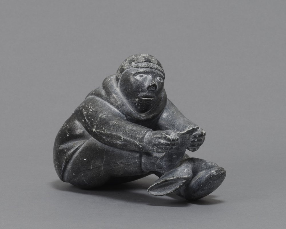 Lukasi Anangi Amamartua (Lucassie Amm), Canadian (Inuit), born 1935,  Seated Man, Counting the Toes on His Right Foot , 1960. Soapstone, 5 7/8 × 4 3/4 × 3 1/8 in. Hood Museum of Art, Dartmouth College: Museum Purchase; 160.34.14538.