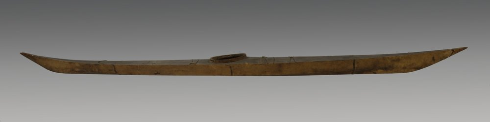 Kalaallit (West Greenlandic Inuit), one-man kayak, about 1887. Wood and sealskin, 256 × 19 1/8 × 9 13/16 in.; weight: 47.5 lb. Hood Museum of Art, Dartmouth College: Gift of the Smithsonian Institution; 47.30.10865.