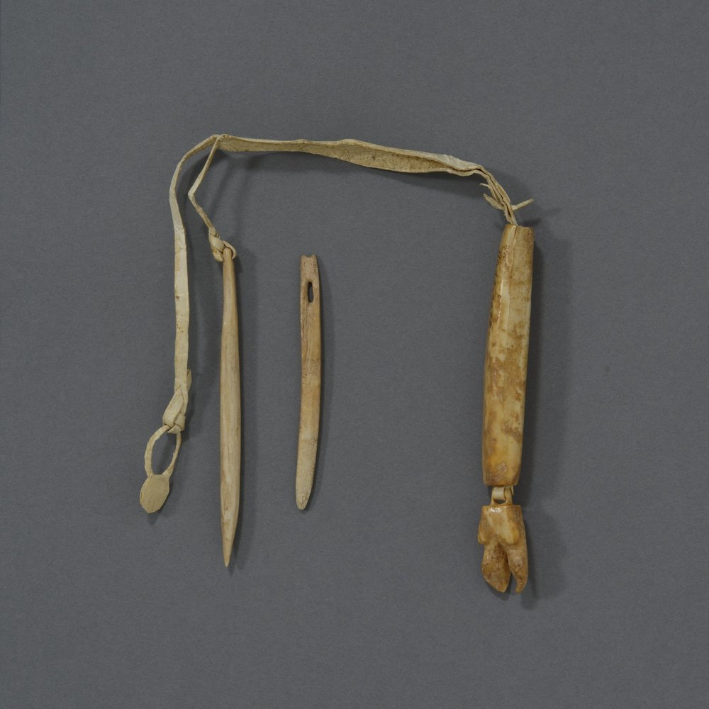 Iñupiaq, ivory needle case with belt thong, collected 1905. Ivory and sealskin strip, height: 3 3/16 in. Hood Museum of Art, Dartmouth College: Bequest of Frank C. and Clara G. Churchill; 46.17.9678.