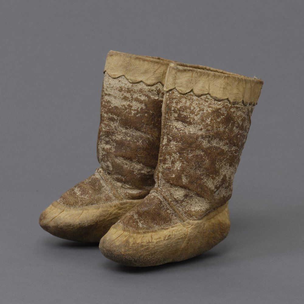 Canadian (Inuit), child's summer boots, collected 1929–30. Sealskin and sinew, 6 1/4 × 1 7/8 × 4 15/16   in. Hood Museum of Art, Dartmouth College: Gift of Robert O. Fernald, Class of 1936; 158.25.14217.