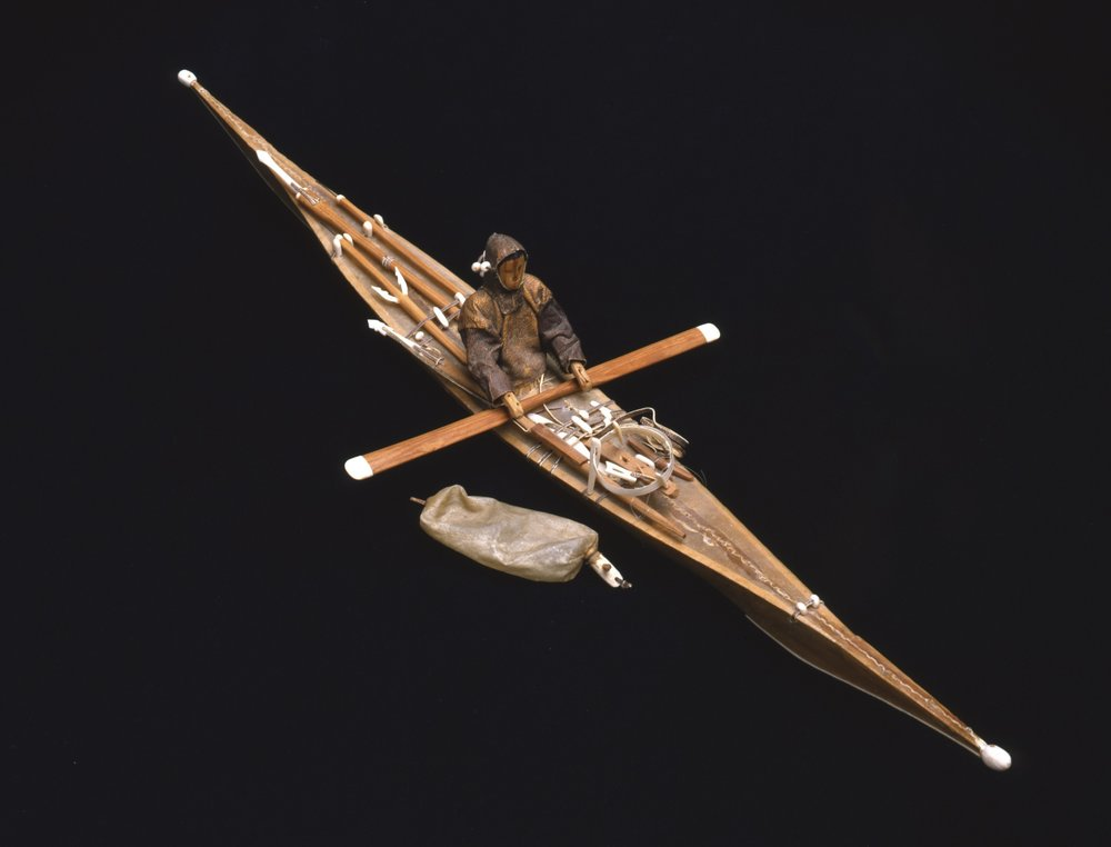 Kalaallit (West Greenlandic Inuit), Souvenir Model Kayak with Paddler and Equipment for Seal Hunting, collected 1950. Wood, seal skin, gut (intestines), bone, and steel, 1 1/2 x 1 15/16 x 23 1/4 in., Hood Museum of Art, Dartmouth College: Gift of Peter S. Dow, Thayer School, Class of 1911; 50.14.12412