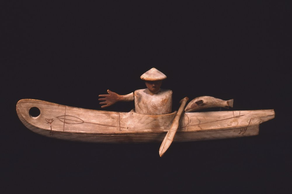 Yup'ik, model kayak with man, paddle, fish and palriayuk (mythological sea monster) design, collected late 1930s. Wood, pigment, and metal, length: 16 1/8 in. Hood Museum of Art, Dartmouth College: Gift of the Estate of Corey Ford, Class of 1921H; 169.75.24874.