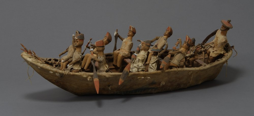 Unangax̂ (Aleut), umiak model, mid-19th century. Wood, hide, cloth, lead hands, pitch, sinew, bird skin, ochre, and thread, 23 5/8 × 7 7/8 × 4 5/16 in. Hood Museum of Art, Dartmouth College: Gift of Captain Worthen Hall and Polly D. Lovewell Hall; 13.1.590.