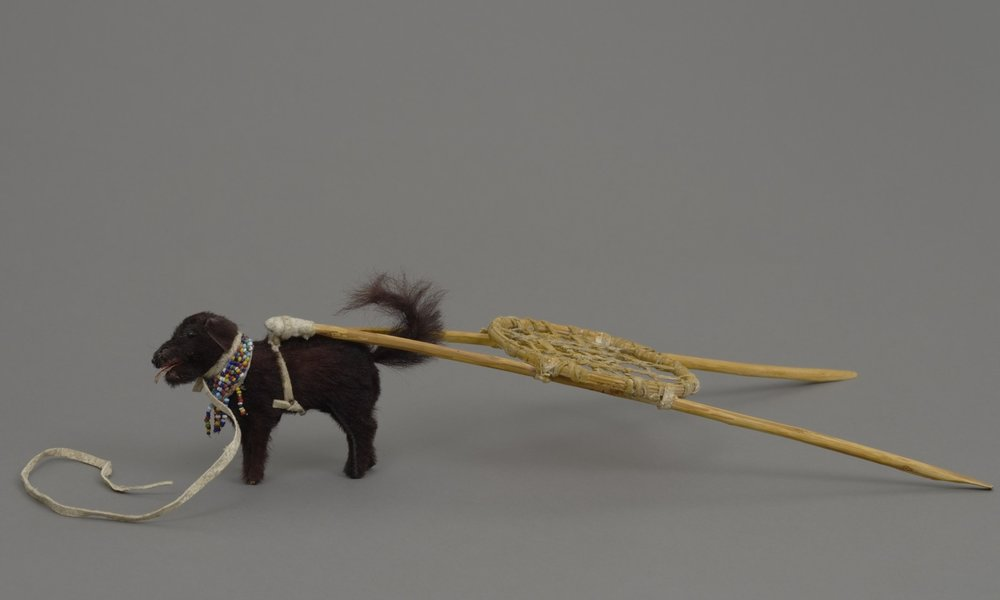 Sioux, figure of a Sioux dog and travois, 1957. Fur, glass trade beads, wood, and string leather, 3 9/16 × 1 1/8 × 5 5/8 in., 7 1/8 × 13 9/16 in. Hood Museum of Art, Dartmouth College: The Wellington Indian Doll Collection, Gift of Barbara Wellington Wells; 987.35.26828.