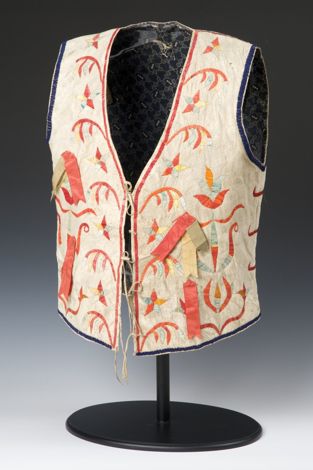 Dakota (Eastern Sioux), vest, about 1880. Native-tanned hide, cotton fabric, porcupine quills, silk ribbons, glass beads, dye, ink, sinew, and thread, 22 1/16 × 13 3/8 in. Hood Museum of Art, Dartmouth College: Gift of Stephen A. Lister, Class of 1963; 2008.82.