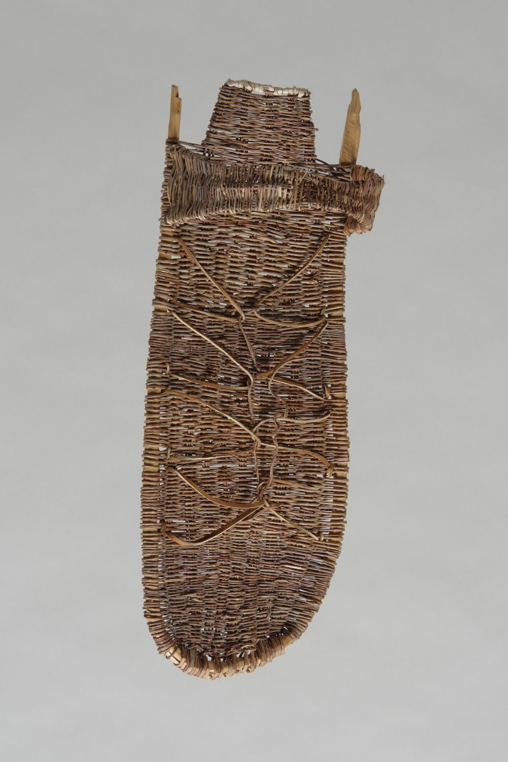 Leonora Quanimptewa, American (Hopi), 1930–1999, Southwest wicker cradleboard, 1970. Wood, sumac, and leather, 28 3/4 × 10 5/8 × 8 1/4 in. Hood Museum of Art, Dartmouth College: Gift of Professor Alfred Frank Whiting; 170.9.25465.