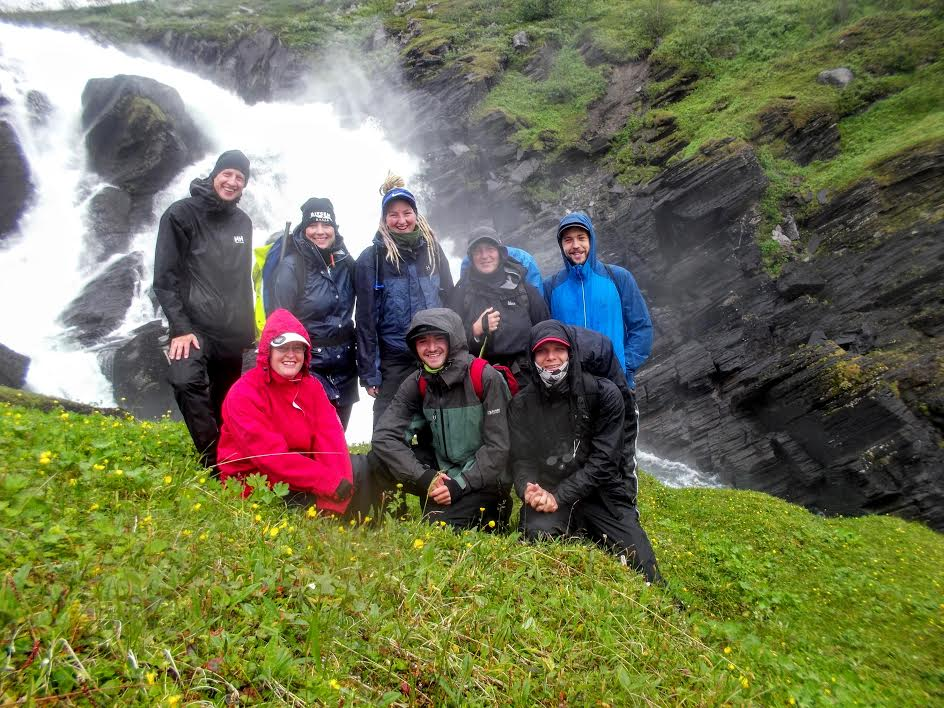 Troy Vegel (lower center) and others pose near a waterfall in the wilderness of northern Sweden.  Photo provided by Troy Vegel.