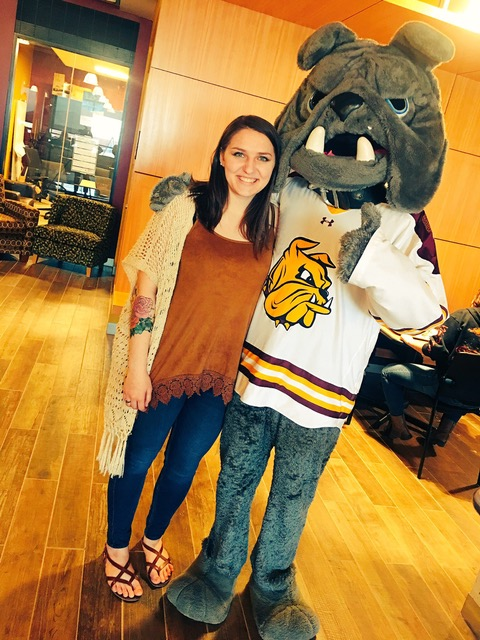 McDonald posing with our fearless mascot, Champ the Bulldog.