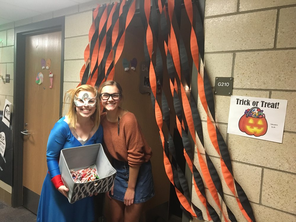 Alexa Anderson and Malorie Hall pose in front of their dorm room.Photo courtesy of Megan Graftaas