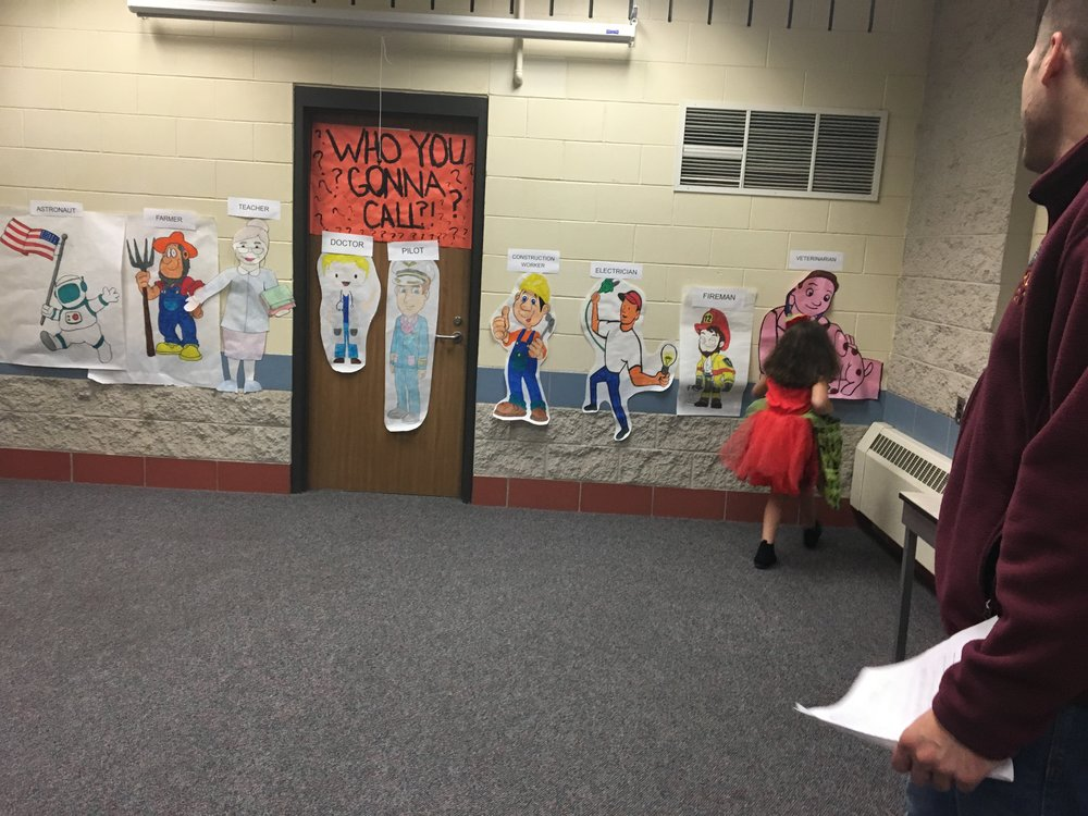 """A child partakes in a game entitled """"Who You Gonna Call?"""" where she has to decide which """"Everyday Hero"""" she would call in a given scenario.Photo courtesy of Megan Graftaas"""