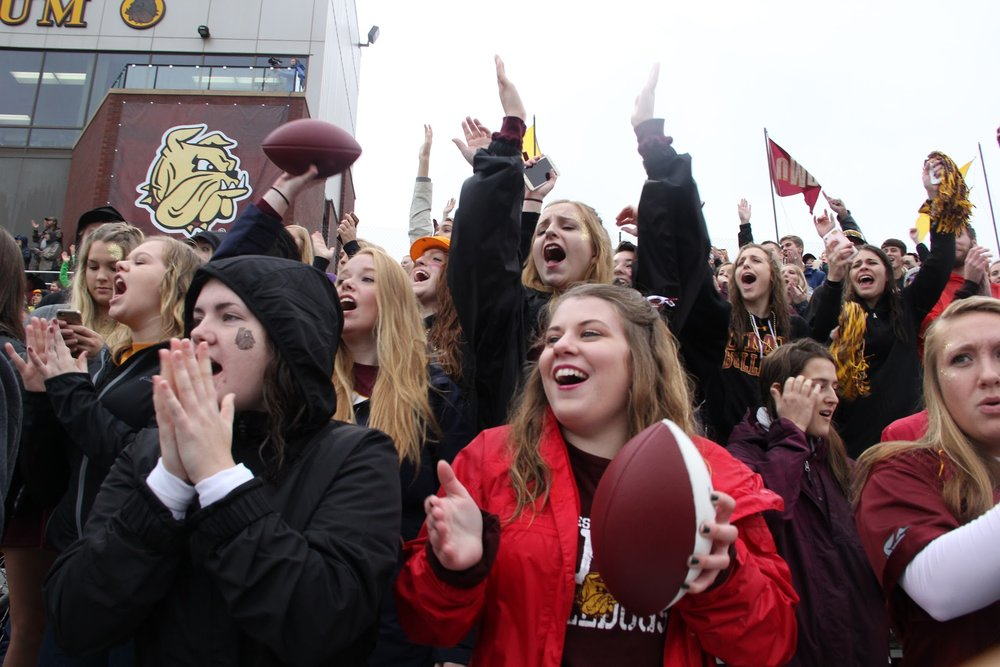 UMD students cheering at the homecoming football game. Photo courtesy of Mat Gilderman.