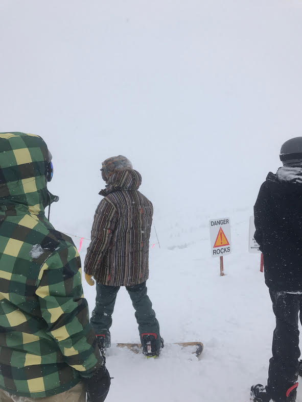 Members of the Ski and Snowboard Club look for direction on the summit of Copper Mountain.  Image: Joey Robinson