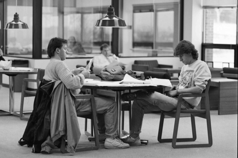 A couple UMD students get caught up on their studies. UMD didn't see a growth of the ODI until 1998 when a committee was established. Photo Courtesy of 19912_informal_kirby