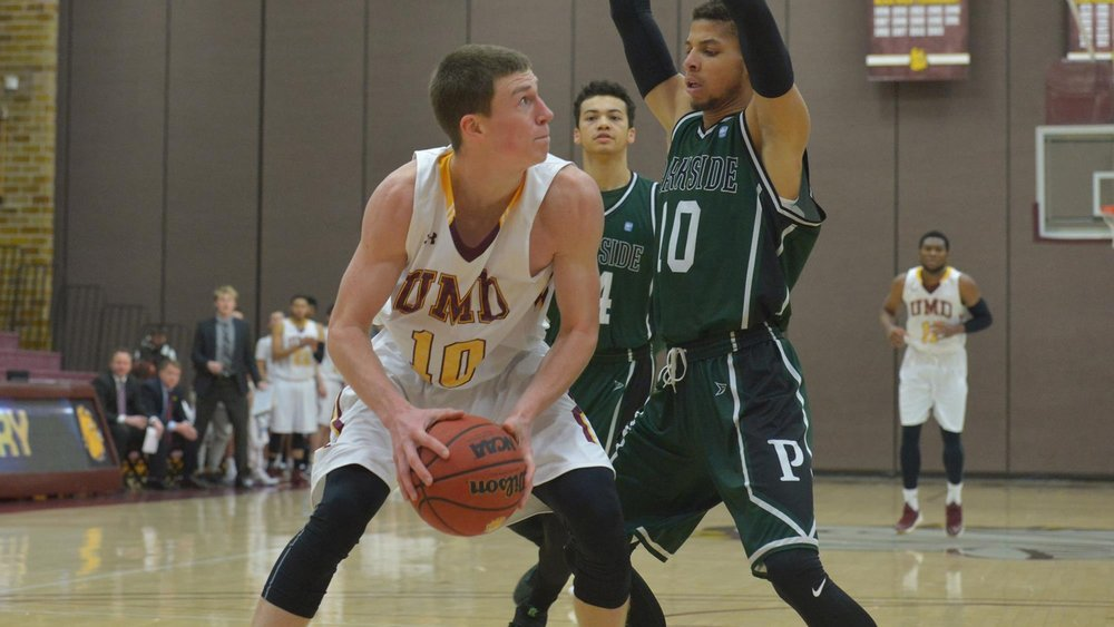 DULUTH, MN - Dec. 19, 2016. Then-freshman Myer scores all seven of his points in the first half against the University of Wisconsin-Parkside Rangers 85-76 loss at home. Photo credit: Brett Groehler