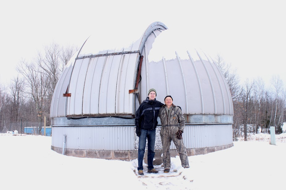 Jay Austin and Glenn Langhorst in front of the observatory in Moose Lake before it was dismantled and brought back to UMD for storage. Photo curtesy of Jay Austin.