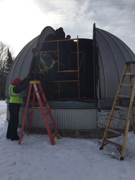 The dome being dismantled for transport in Moose Lake, Minnesota. AW Kuettle was contracted to do the work. The dome will be stored at UMD until construction on the new observatory begins. Photo curtesy of Jay Austin.