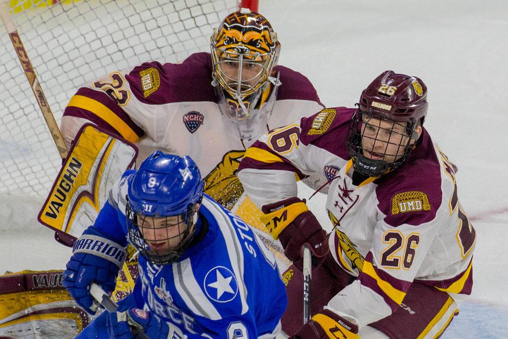 Jade Miller battles in front of the UMD net. Photo courtesy of Jim Rosvold