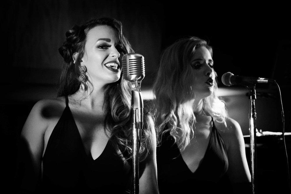 Lisa Holmann (L) and Cally Nielsen (R) singing together Photo by Glenn Blaszkiewicz