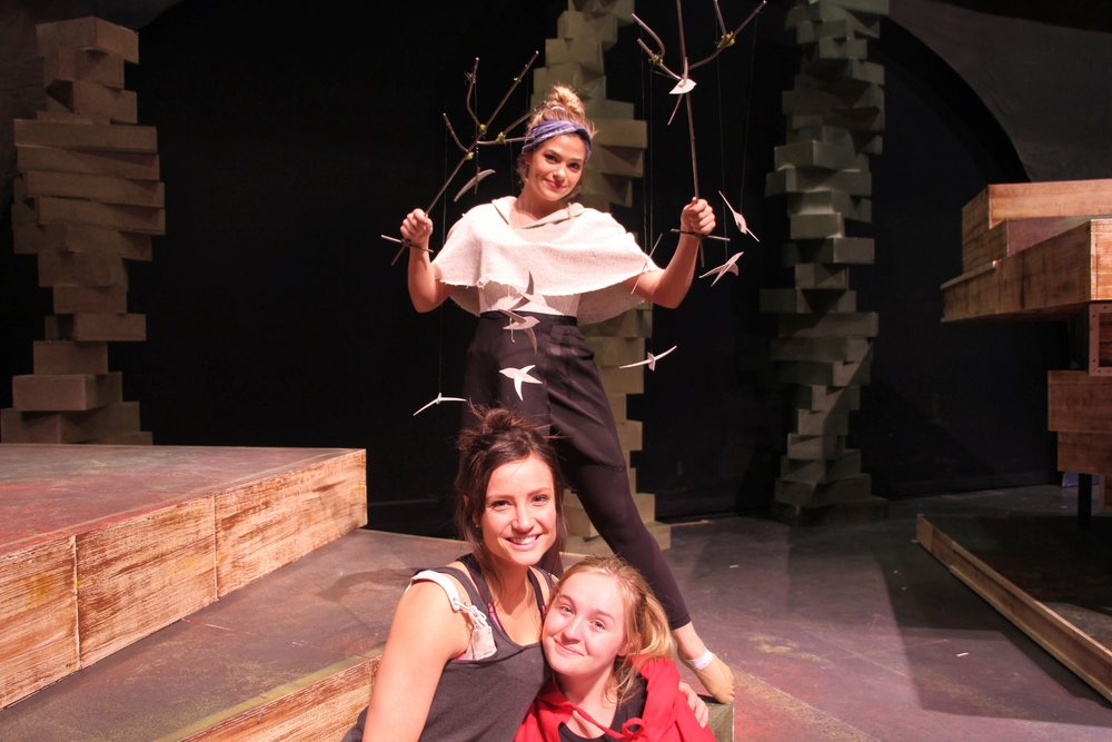 Camryn Buelow (top), Amelia Barr, and Rachel Williams pose during rehearsal. Photo by Jakob Bermas