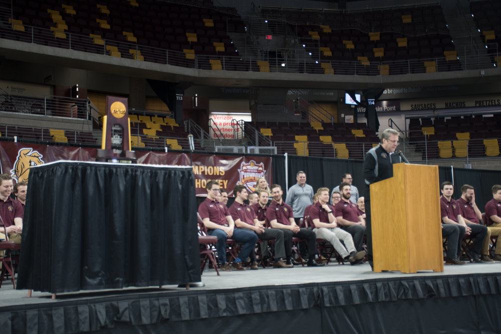 Head Coach Scott Sandelin addresses the fans gathered at Amsoil Arena. Photo by: Connor Shea