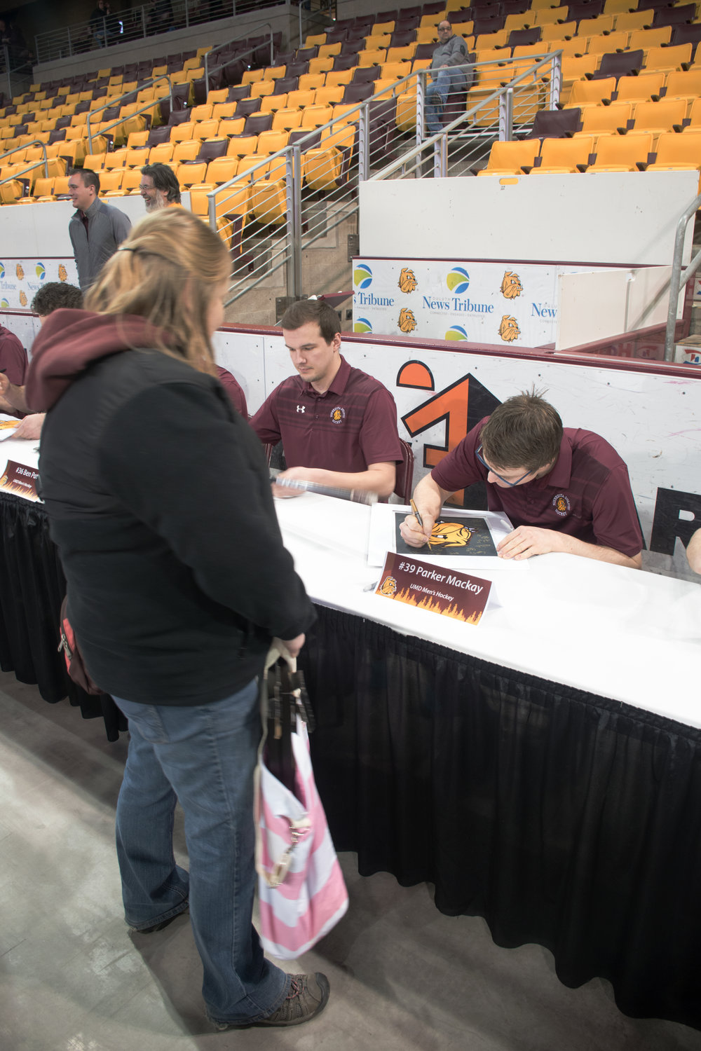 Parker Mackay signs a fan's poster while signing autographs at Amsoil Arena. Photo by: Connor Shea
