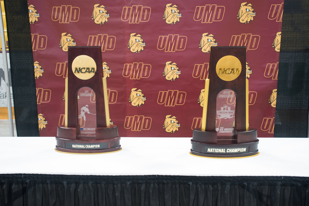 UMD's two division one men's hockey trophies sit side by side, 2011 on the left and 2018 on the right. Photo by: Connor Shea