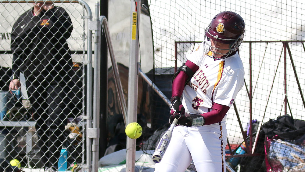 Hannah Schmoll takes a swing against the University of Minnesota-Crookston. Photo courtesy of Dave Harwig