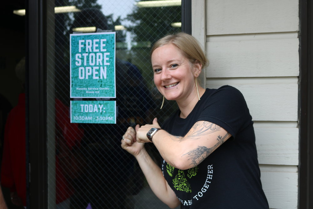 Jonna Korpi, Office of Sustainability activities coordinator, welcomed people heading inside the Free Store on Aug. 21, 2018 at  Heaney  Service Center. Korpi was put in charge by Housing and Residence Life. Photo by Brianna Taggart