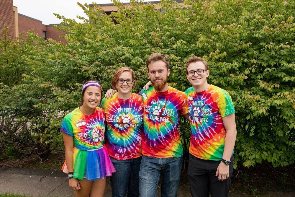 Welcome Week interns Lauren Kotz, Paul Cerar and Jacob G. Larsen pose with Emily Borra. Photo by Nick Vittorio