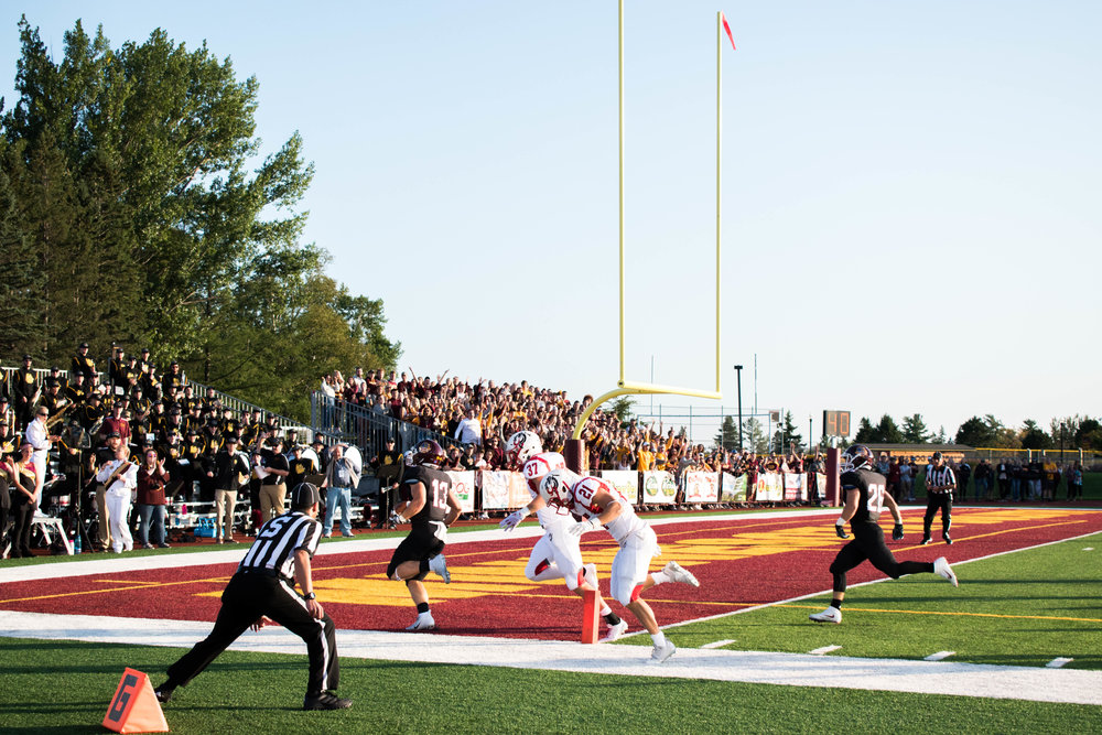 Jason Balts scores one of his three touchdowns in the first quarter during Saturday's game. Photo by: Karli Kruse.