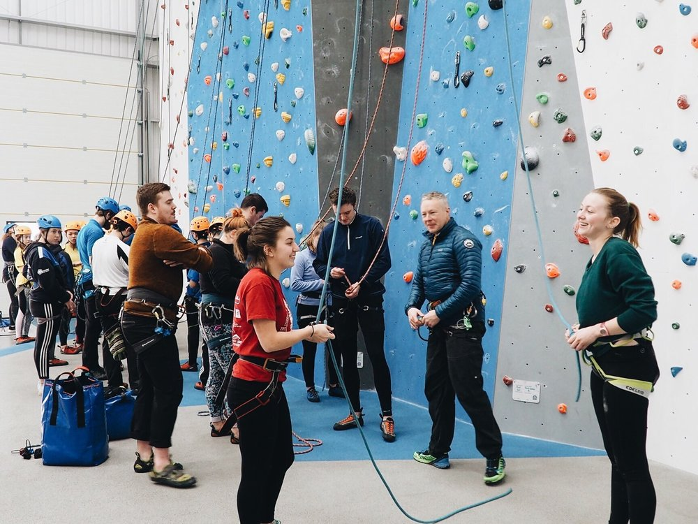 """Emma McLarnan taking a climbing course while studying abroad in England in Spring 2018. McLarnan is a climbing instructor for RSOP and likes Women on the Wall because it allows for women climbers to face their fears in a """"safe place."""" Photo courtesy of Emma McLarnan"""