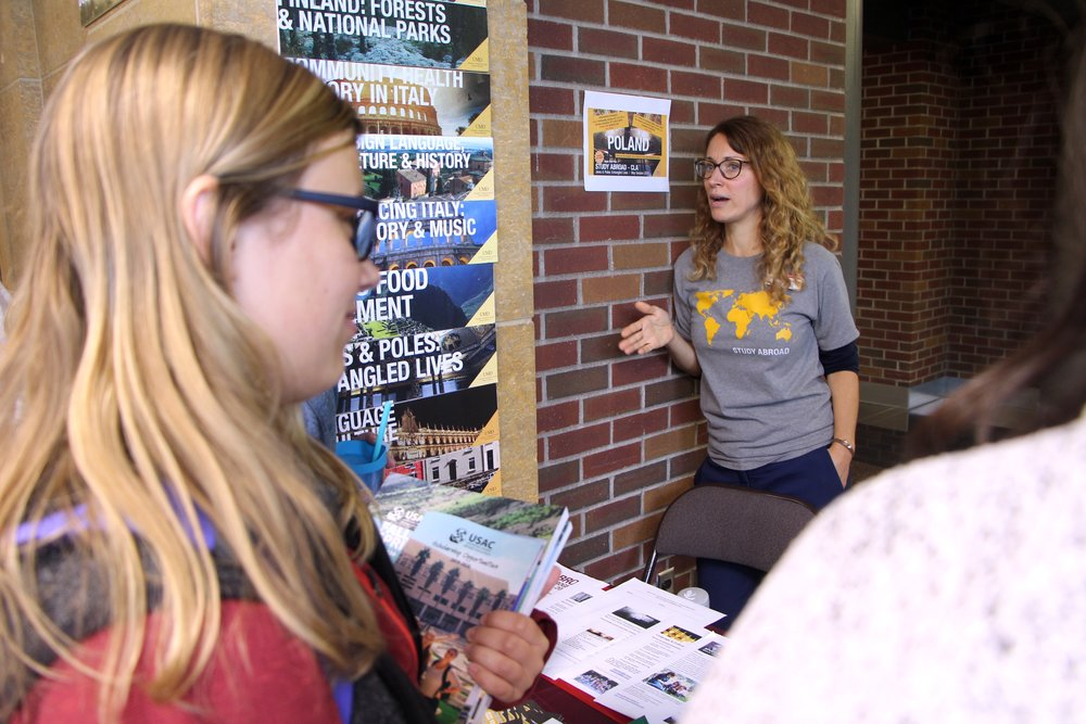 Lyndsey Andersen, the associate director for the Study Abroad Office, at the Study Abroad Fair on Sept. 20, 2018. Andersen wants to help encourage all students to study abroad. Photo by Zack Benz