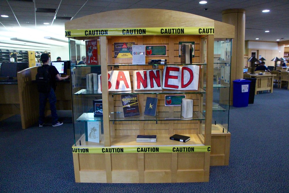 The Banned Books display case in the Kathryn A. Martin Library on Sept. 21, 2018. This display case is up for the entire month of September showcasing some of the many frequently banned and challenged books in libraries and schools. Photo by Brianna Taggart