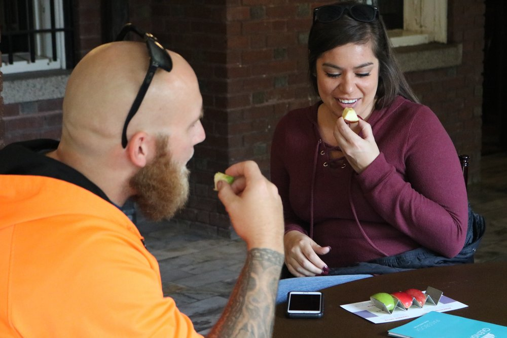 Glensheen visitor Melissa Paasch eating a flight of apples at the end of her tour on Sept. 30, 2018. Paasch is from Apple Valley, Minnesota, and Honeycrisp apples are her favorite. Photo by Zack Benz