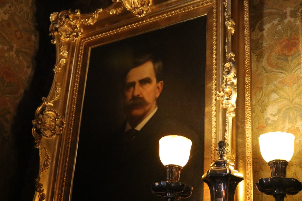 The painting of Chester Congdon hanging in the library of Glensheen Mansion. There are over 2,000 pieces of art in Glensheen's collection, according to tour guide Jack Harrington. Photo by Zack Benz