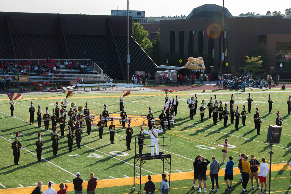 UMD Bulldog Marching Band performing at a football game on Malosky Stadium. Photo by Karli Kruse